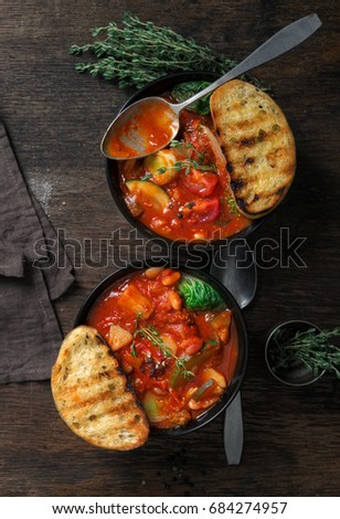Two bowl of soup minestrone with seasonal vegetables on wooden table, top view. Italian food #684274957