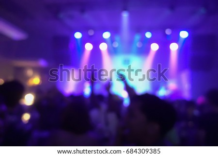 Blur background of concert crowd in front of bright stage lights musics #684309385