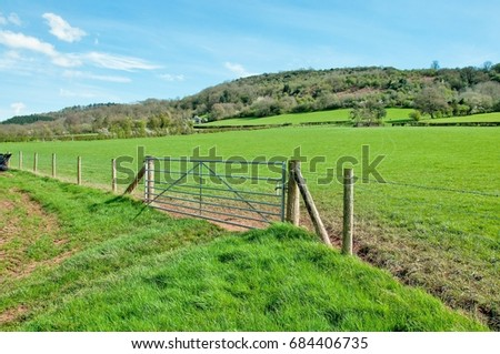 Springtime farm gate and farming landscape in the English countryside. #684406735