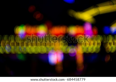 Defocused urban abstract texture background for your design. Multicolored defocused bokeh lights background. #684458779
