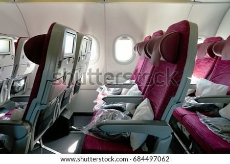 MOSCOW, RUSSIA - CIRCA JUNE, 2017: inside Qatar Airways Airbus A320. Qatar Airways, is the state-owned flag carrier of Qatar. #684497062