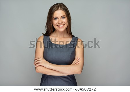 Isolated portrait of smiling  business woman with crossed arms.