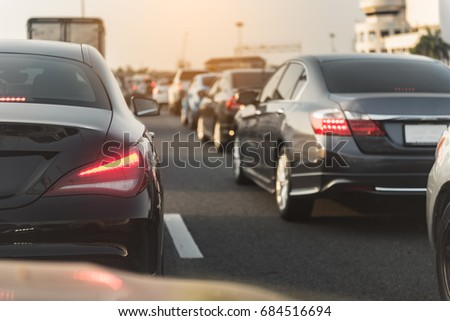 traffic jam with row of cars on toll way, during rush hour #684516694