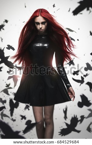 Beautiful goth mistress evil girl in black latex dress