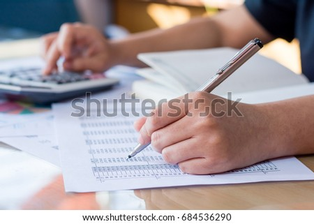 woman hand using calculator and writing make note with calculate #684536290