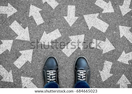 One standing on the road to future life with many direction sign point in different ways. Decision making is very hard to design. Royalty-Free Stock Photo #684665023