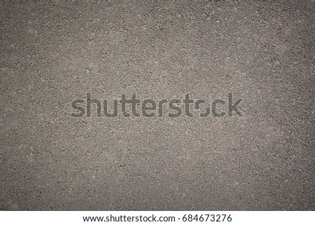 Grey background texture of rough asphalt, top view, copy space #684673276