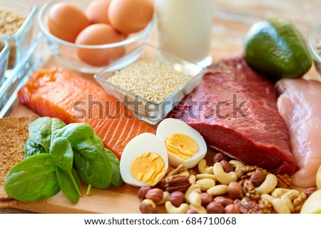 healthy eating and diet concept - natural rich in protein food on table #684710068