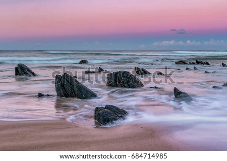 Pink moving waves on the Mpekweni beach on the Indian Ocean Coastline of South Africa. #684714985