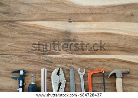 Work Tools frame on wood background #684728437