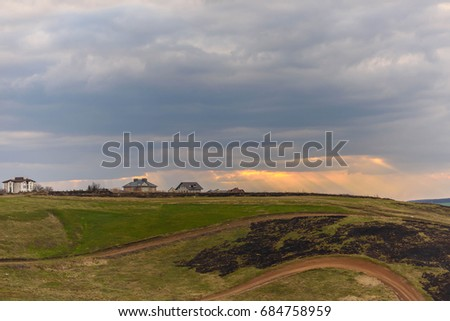 Provincial landscape at sunset on a rainy day #684758959