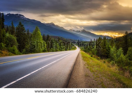 Scenic Icefields Pkwy in Banff National Park at sunset. It travels through Banff and Jasper National Parks and offers spectacular views of the Rocky mountains. #684826240