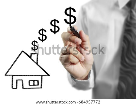Businessman hand drawing a house  #684957772