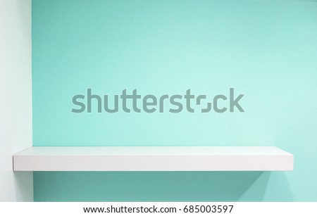 Empty white shop shelf, retail shelf on blue sky vintage background. Royalty-Free Stock Photo #685003597