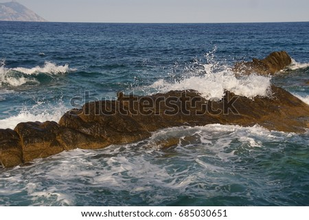 Waves hitting rock #685030651