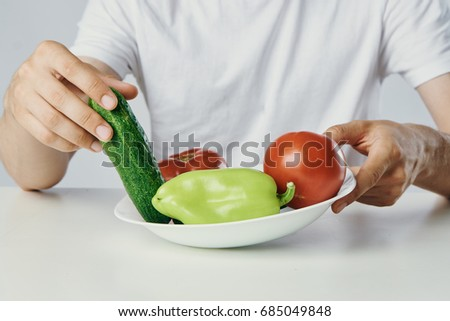 Man with beard on white isolated background holds plate with vegetables, diet, vegetarian. #685049848
