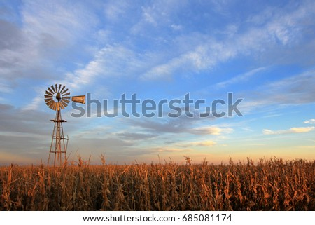 Texas style westernmill windmill at sunset, Argentina, South America #685081174