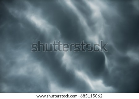 Motion of Dark sky and black clouds before rainy, Dramatic black cloud and thunderstorm #685115062