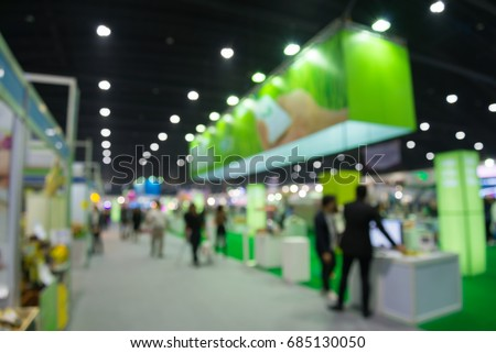 Abstract blur people in trade show expo background Royalty-Free Stock Photo #685130050