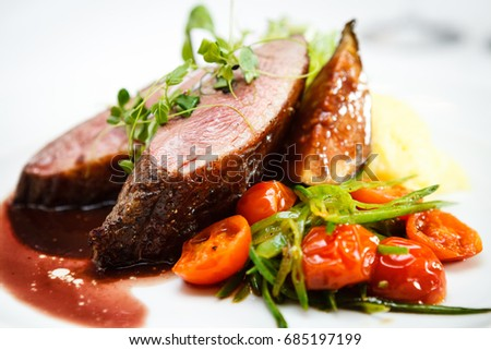 Glazed duck fillet, mashed potatoes seasoned with truffle oil, fig and aniseed sauce #685197199