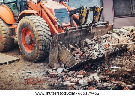 Hydraulic crusher, industrial excavator machinery working on construction site demolition Royalty-Free Stock Photo #685199452