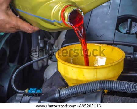 hand fill up in a car engine with transmission oil #685205113