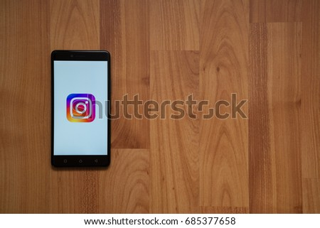 Los Angeles, USA, july 13, 2017: Instagram logo on smartphone screen on wooden background. #685377658