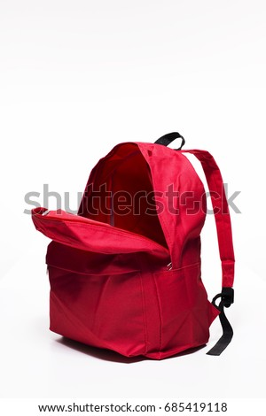 Open red school backpack on white background Royalty-Free Stock Photo #685419118