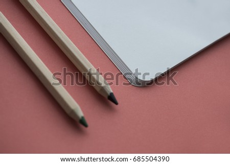 Blank notebook and pencil isolated on background #685504390