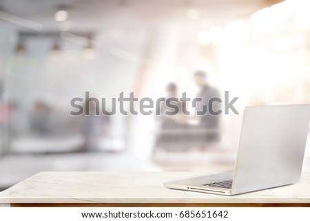 Office workplace with laptop and copy space on marble table.