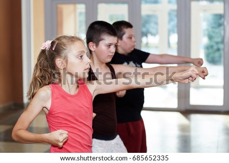 Children are training punch the hand Royalty-Free Stock Photo #685652335