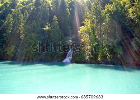Hidden waterfall close to a lake in Central Switzerland. #685709683