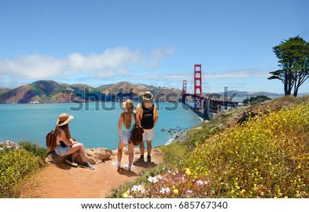 Family looking at beautiful summer mountains landscape, on hiking trip.  Golden Gate Bridge, over Pacific Ocean, mountains in the background. San Francisco, California, USA #685767340