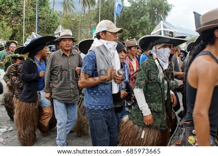 COTACACHI, ECUADOR - JUNE 29, 2017: Men's parade at Inti Raymi, the indigenous solstice festival, with a history of violence in the village #685973665