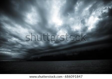 Cloudy storm in the sea before the rain. tornado storms cloud above the sea. Monsoon season. Hurricane Florence. Hurricane Katrina. #686091847
