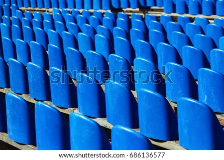 Set of blue empty plastic chairs. Preparation for the holiday outdoors. #686136577