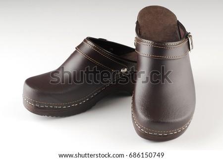 Beautiful modern pair of brown clogs  #686150749