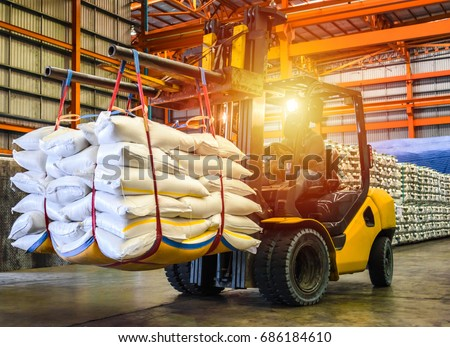 Forklift handling sugar bag for stuffing into container for export. Distribution, Logistics Import Export, Warehouse operation, Trading, Shipment, Delivery concept. #686184610