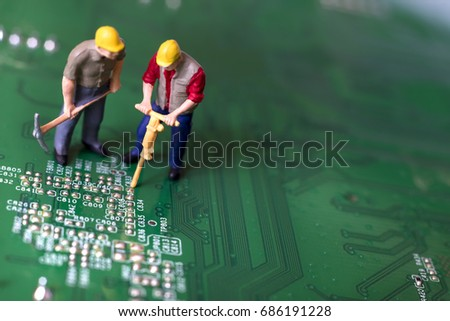 Miniature Workers On Circuit Board #686191228