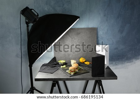 Photo studio with professional lighting equipment during shooting food