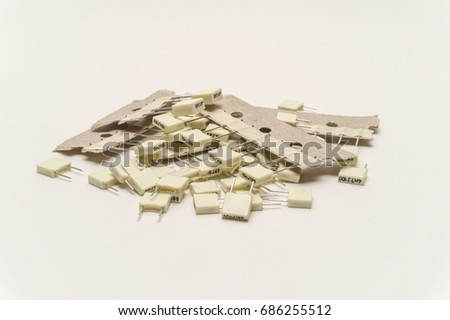 A small pile of non-polarized capacitors of different values #686255512