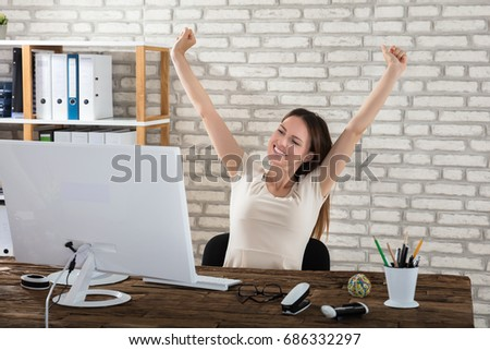 Happy Young Businesswoman Stretching Her Arms At Workplace #686332297