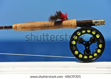 Close up shot of saltwater fly fishing tackle against sea #68639305