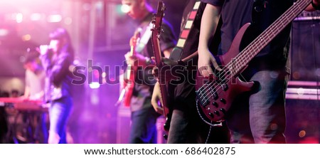 Guitarist on stage for background, soft focus and blur concept #686402875