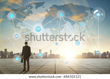 International business concept with businessman on city skyline background with network on map and sunlight #686502121