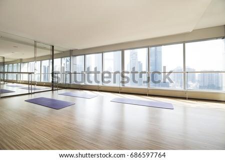 Empty yoga studio and cityscape #686597764