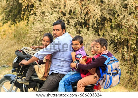 KOLKATA, INDIA - Nov 27: Unidentified students in uniform go back home by motorcycle after classes on November 27, 2015. #686603824