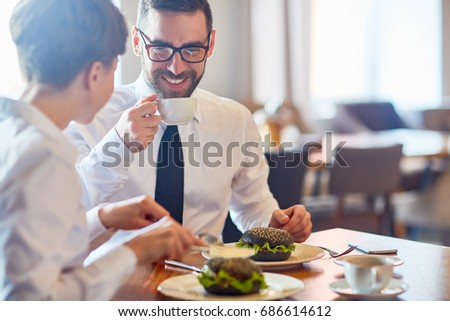 Business people interacting by lunch in restaurant #686614612