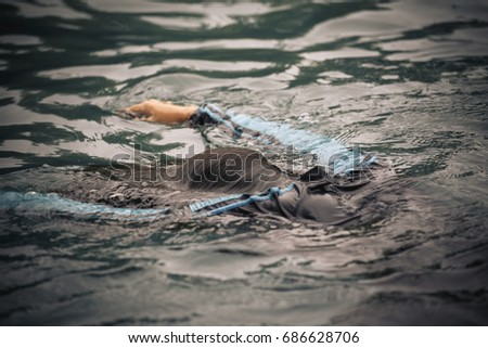 Drowning people raise hands for help in the pool. Royalty-Free Stock Photo #686628706