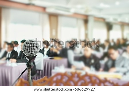 Businessmen discuss about business secret issues beside off microphone in meeting room #686629927